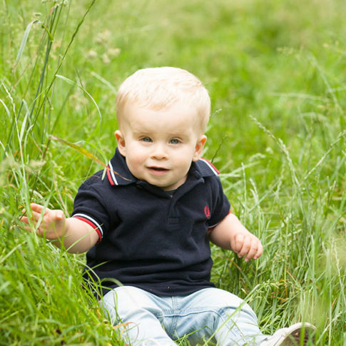 toddler-in-long-grass-at-Abney-Hall
