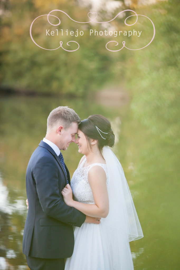 Styal Lodge wedding photography of the bride and groom at the lake.