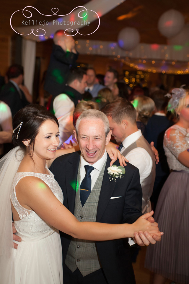 Styal Lodge wedding photography of the bride and her father dancing at the wedding reception.