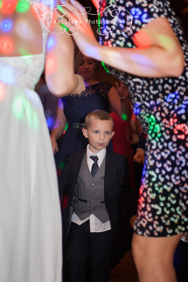 Styal Lodge wedding photography of a little boy dancing in between the grown ups.
