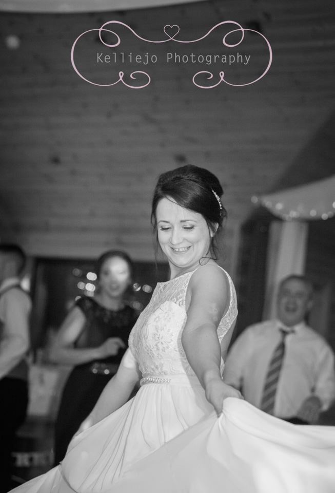 Styal Lodge wedding photography of the bride on the dance floor at the wedding reception.