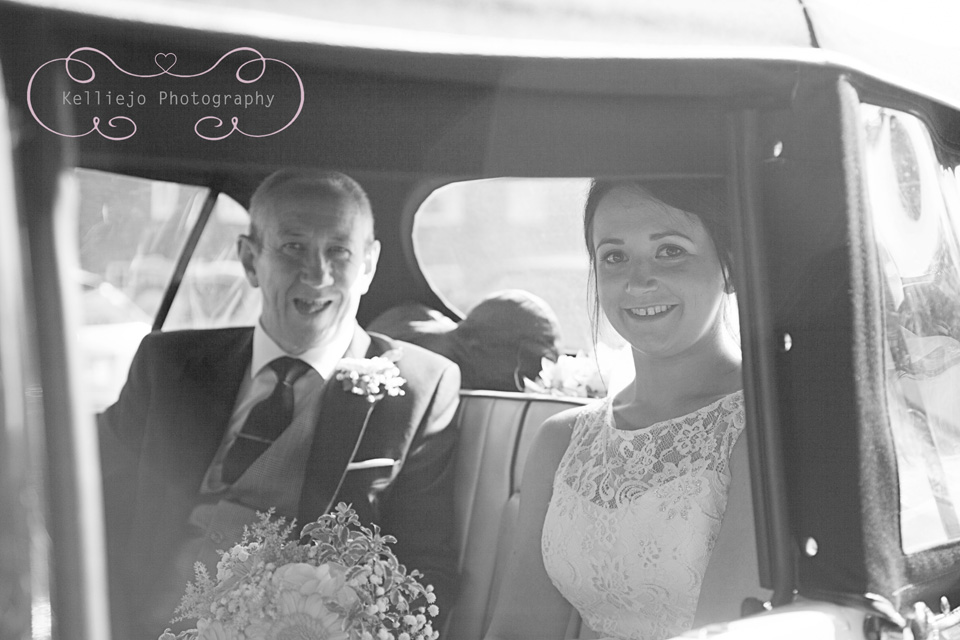 Styal Lodge wedding photography of the bride and her Dad in the wedding car.
