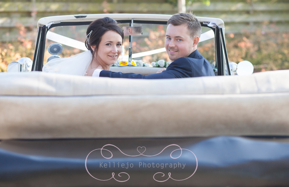 Styal Lodge wedding photography of the bride and groom in the wedding car.
