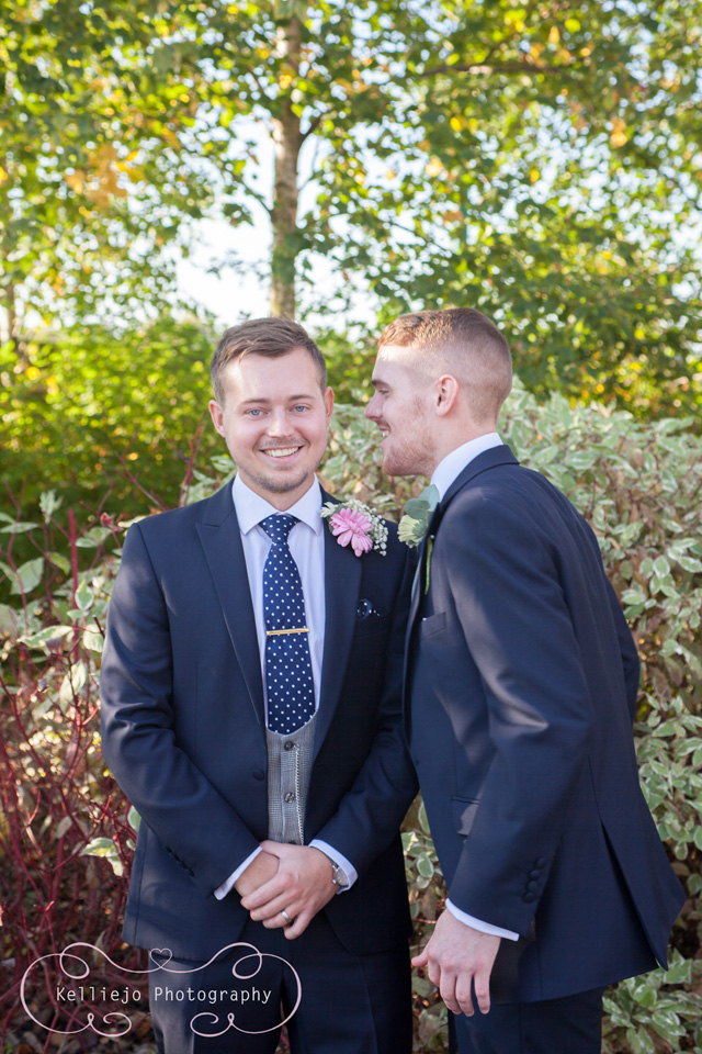 Styal Lodge wedding photography of the groom laughing with the best man.