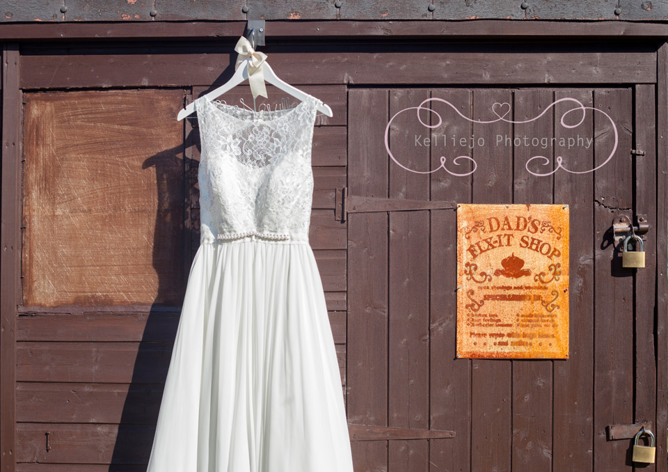 Styal Lodge wedding photography of the wedding dress hanging on a shed.