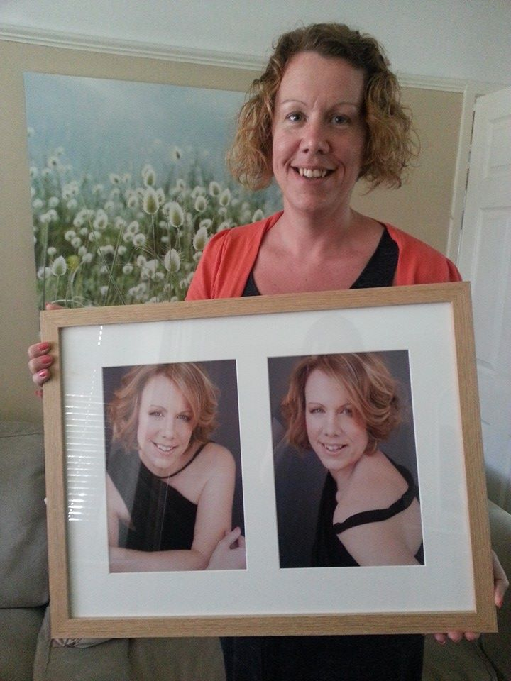 Cheshire women's photography of a lady holding up the double frame that she has bought.
