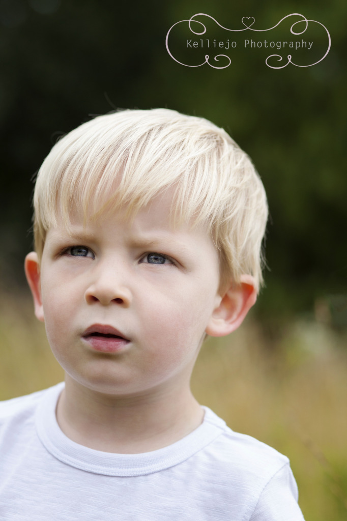 Children's photography of a young boy looking into the distance at Abney Hall Park.